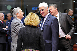 Allistar Darlling, the UK's chancellor of the exchequer,  center right, speaks with Elena Salgado, Spain's finance minister, center left, while Jean-Claude Trichet, president of the European Central Bank, far left, greets Wouter Bos, the Netherlands's finance minister, far right, during the meeting of European finance ministers, at EU Council headquarters in Brussels, Belgium, on Tuesday, Feb. 16, 2010. (Photo © Jock Fistick)