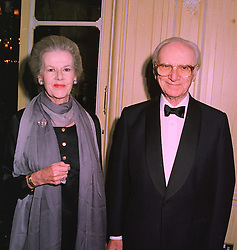SIR PETER & LADY O'SULLEVAN at a dinner in London on 19th November 1997.<br /> MDM 26