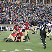 Harvard celebrate a last minute interception to seal victory  during the Harvard Vs Yale, College Football, Ivy League deciding game, Harvard Stadium, Boston, Massachusetts, USA. 22nd November 2014. Photo Tim Clayton