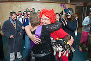 Participants in the Cathy Waller Challenge congratulate Cathy Waller. Photo by Ben Siegel