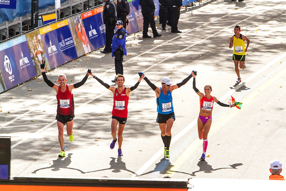 ING New York CIty Marathon: elated runners hold hands as they approach finish line