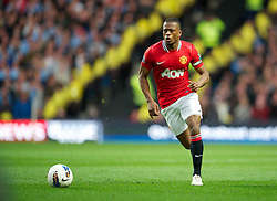 MANCHESTER, ENGLAND - Monday, April 30, 2012: Manchester United's Patrice Evra in action against Manchester City during the Premiership match at the City of Manchester Stadium. (Pic by David Rawcliffe/Propaganda)