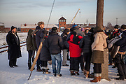 A group of visitors at the Auschwitz Birkenau site. It is estimated that between 1.1 and 1.5 million Jews, Poles, Roma and others were killed in Auschwitz during the Holocaust in between 1940-1945.