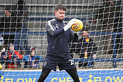 AFC Wimbledon goalkeeper Joe McDonnell (24) warming up during the EFL Sky Bet League 1 match between AFC Wimbledon and Northampton Town at the Cherry Red Records Stadium, Kingston, England on 10 February 2018. Picture by Matthew Redman.