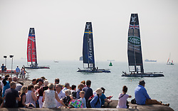 © Licensed to London News Pictures. 22/07/2016. Portsmouth, United Kingdom.  Spectators preparing to watch the teams practice for the America's Cup World Series (ACWS) in Portsmouth this weekend, 22nd-24th July 2016. British Olympic sailing legend, Sir Ben Ainslie, is leading his all-British team, Land Rover BAR, against other teams in a battle to qualify for a place in the two team America's Cup final, to be held in Bermuda in 2017. Today (22/07/16) is a practice day, followed by two days of racing. Photo credit: Rob Arnold/LNP