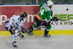 Matej Hocevar (HDD Tilia Olimpija, #14) vs Daniel Fekete (Sapa Fehervar AV19, #91) during ice-hockey match between HD Tilia Olimpija and HK Acroni Jesenice  in 8th Round of EBEL league, on October 3, 2010 at Hala Tivoli, Ljubljana, Slovenia. (Photo By Matic Klansek Velej / Sportida.com)