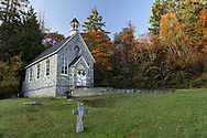 St. Paul's Church at Fulford Harbour on Salt Spring Island, British Columbia, Canada.  The historic church was founded in 1878 and built between 1880 and 1885.  The cross in the foreground is part of the church cemetery and marks the resting place of Alan Blackburn (1865-1925).