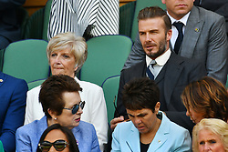 © Licensed to London News Pictures. 02/07/2016. SANDRA GERGiNA WEST and son DAVID BECKHAM watchs tennis from the Royal Box on the centre court on the sixth day of the WIMBLEDON Lawn Tennis Championships.  London, UK. Photo credit: Ray Tang/LNP