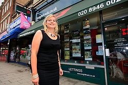 """UNITED KINGDOM WIMBLEDON 26JUN09 - Becky Manwaring, estate agent at the Frank Knight agency in Wimbledon poses for a picture outsider her workplace. She brokered the deal for Boris Becker's new home in London. The newlyweds Boris Becker & Sharlely """"Lilly"""" Kerssenberg have recently moved into a 6-million pound property in Burghley Road, Wimbledon, London...jre/Photo by Jiri Rezac..© Jiri Rezac 2009"""