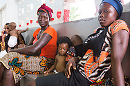 Mothers with their children wait for check in at the EMERGENCY Surgical and Paediatric Centre in Goderich - Freetown (July 20, 2016). This Emergency Hospital is the most frequented hospital for emergency cases. Every accident from Freetown and sometimes from the outside is being brought in here. The treatment is free.<br /> <br /> The kids are first being measured, weighted and then checked by the nurses.<br /> <br /> The EMERGENCY project is funded by the European Commission.<br /> <br /> EMERGENCY has designed this project upon request of its local partners, WARDC and PGRMI. The project's strategy is based on a comprehensive approach involving Non State Actors and Local Authorities in order to improve the efficiency of the health sector and to establish good intersectorial practices in the field of health and education. EMERGENCY puts in place a structured system for civil society organizations, local authorities and government institutions where everyone can contribute to improving health service delivery and education standards at the WARD area. It will also deliver promotion campaigns which will address children, teachers and communities about the availability of the three national health programs (FHCI, NMCP and SFP) and about how to access basic services by informing them about their rights.