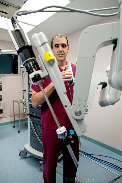 2011 Quality Campaign,  Saint Mary's Hospital. Dr. Mark Albini with robotic surgery unit.(Photo by Robert Falcetti)