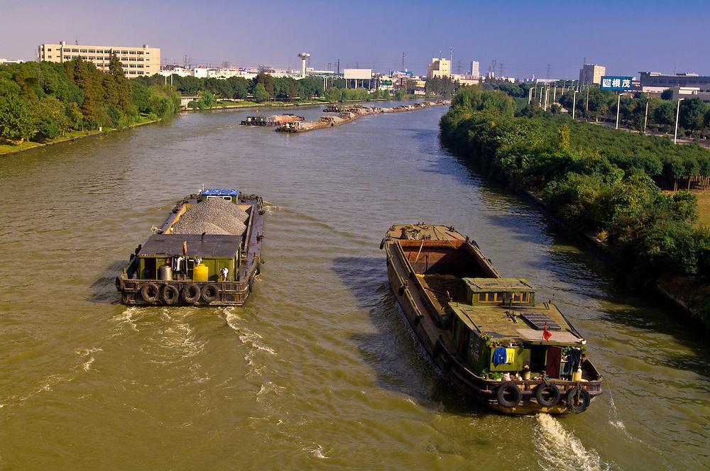 Barges moving along the Grand Canal, Jiangsu Province between Zhouzhuang and Suzhou, China