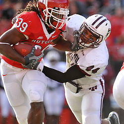 Oct 10, 2009; Piscataway, NJ, USA; Rutgers running back Jourdan Brooks (39) straight arms Texas Southern linebacker Dejuan Fulghum (44) during first half NCAA college football action between Rutgers and Texas Southern at Rutgers Stadium.