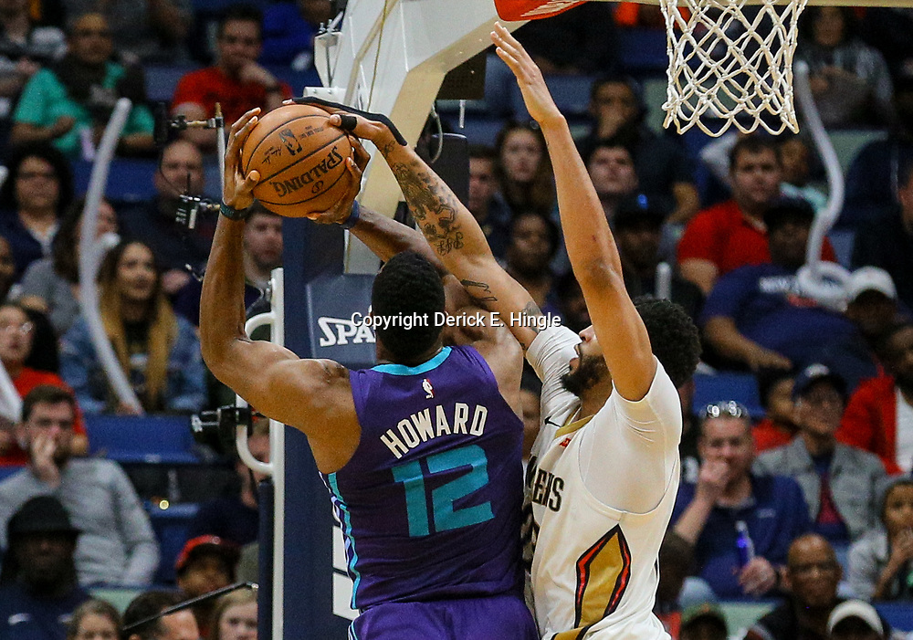 Mar 13, 2018; New Orleans, LA, USA; New Orleans Pelicans forward Anthony Davis (23) blocks a shot by Charlotte Hornets center Dwight Howard (12) during the fourth quarter of a game at the Smoothie King Center. The Pelicans defeated the Hornets 119-115.  Mandatory Credit: Derick E. Hingle-USA TODAY Sports