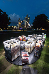 © Licensed to London News Pictures. 31/08/2017. LONDON, UK. MARIA ARCEO, artist poses next to her installation, 'Future Dust'. For the last year, Arceo has been collecting plastic from over 40 beaches along the tidal Thames down to the Estuary. By beachcombing, handpicking, identifying, and colour-coding found plastic debris, she will create a large-scale artwork that responds to the sheer scale of plastic litter that is being deposited into the Thames. Illuminated by Dutch interactive light artist Tim Scheffer.  Photo credit: Vickie Flores/LNP