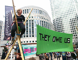 G8 Demonstration in Canary Wharf.<br /> Activists hold a banner at a demonstration against the upcoming G8 meeting in London, Canary Wharf, London, United Kingdom<br /> Friday, 14th June 2013<br /> Picture by Max Nash / i-Images