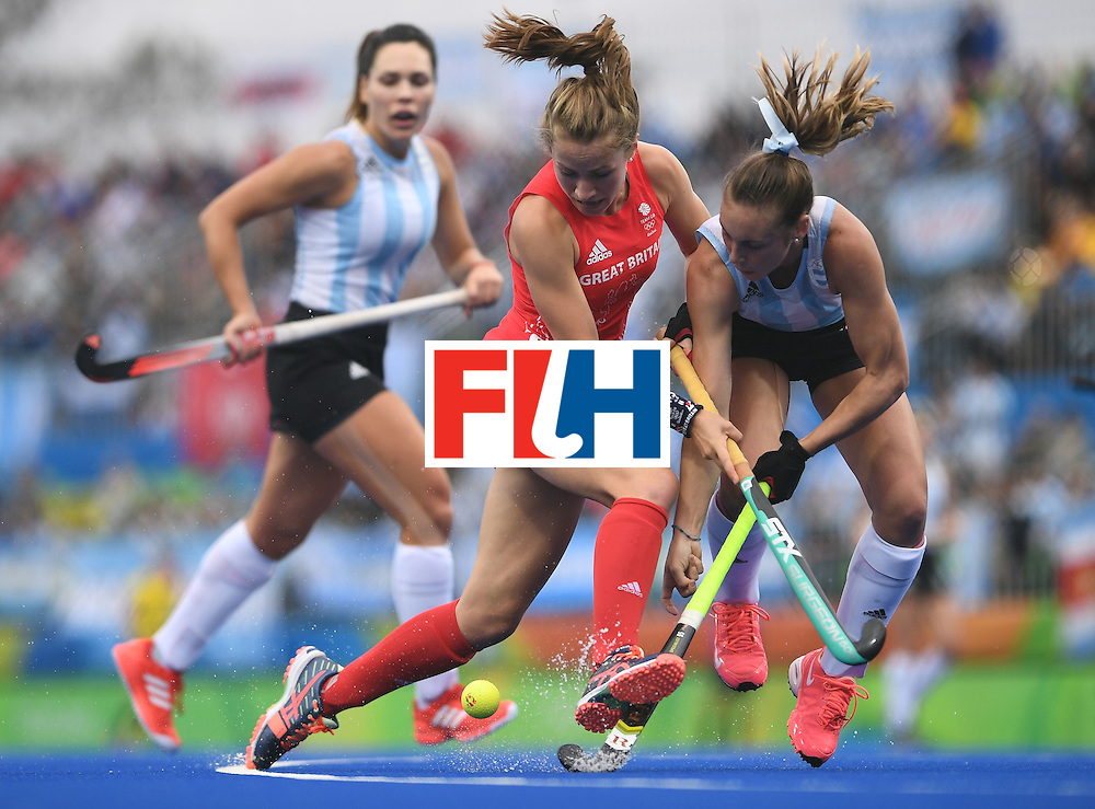 Britain's Shona McCallin (C) fights for the ball with Argentina's Florencia Habif (R) during the women's field hockey Britain vs Argentina match of the Rio 2016 Olympics Games at the Olympic Hockey Centre in Rio de Janeiro on August, 10 2016. / AFP / MANAN VATSYAYANA        (Photo credit should read MANAN VATSYAYANA/AFP/Getty Images)