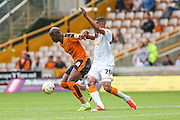 Wolves Benik Afobe & Hull's Isaac Hayden during the Sky Bet Championship match between Wolverhampton Wanderers and Hull City at Molineux, Wolverhampton, England on 16 August 2015. Photo by Shane Healey.