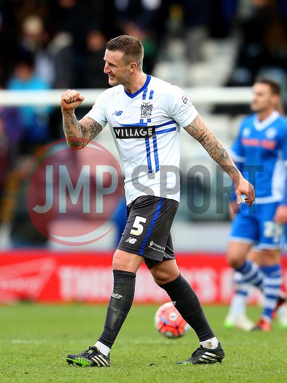 Peter Clarke of Bury celebrates victory at full time - Mandatory byline: Matt McNulty/JMP - 06/12/2015 - Football - Spotland Stadium - Rochdale, England - Rochdale v Bury - FA Cup