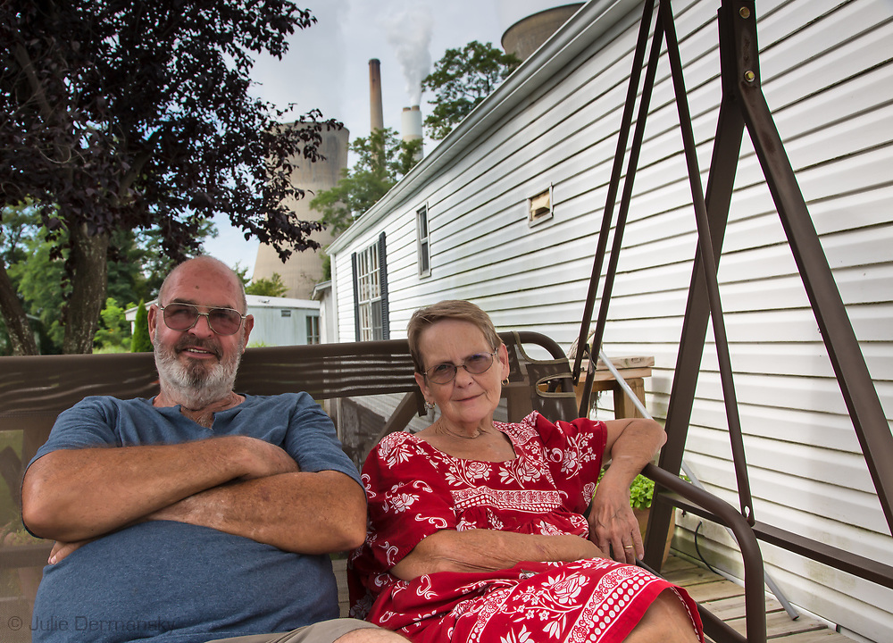 The Glens on their deck outside of their trailer home in Raymond City, West Virginia across from the John Amos coal-fired power plant.