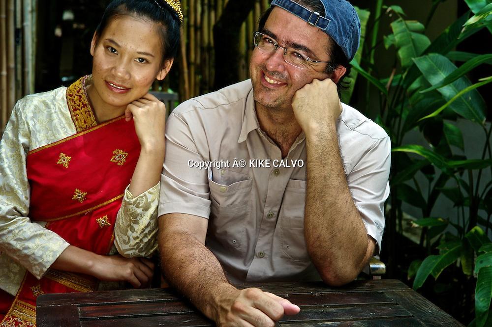 Photographer Kike Calvo with Teen girl wearing a Lao Lom wedding dress.