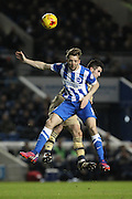 Lewis Cook and Dale Stephens during the Sky Bet Championship match between Brighton and Hove Albion and Leeds United at the American Express Community Stadium, Brighton and Hove, England on 24 February 2015. Photo by Stuart Butcher.