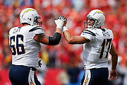 KANSAS CITY, MO - SEPTEMBER 30: Philip Rivers #17 and Jeromey Clary #66 of the San Diego Chargers celebrate after a touchdown against the Kansas City Chiefs during the game at Arrowhead Stadium on September 30, 2012 in Kansas City, Missouri. The Chargers won 37-20. (Photo by Joe Robbins) *** Local Caption *** Philip Rivers;Jeromey Clary