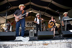 05 May 2012. New Orleans, Louisiana,  USA. .New Orleans Jazz and Heritage Festival. .L/R; Frontman Ray Benson, fiddler Jason Roberts, Elizabeth McQueen and Eddie Rivers of the American country band 'Asleep at the Wheel,' winners of 9 Grammy awards..Photo; Charlie Varley.