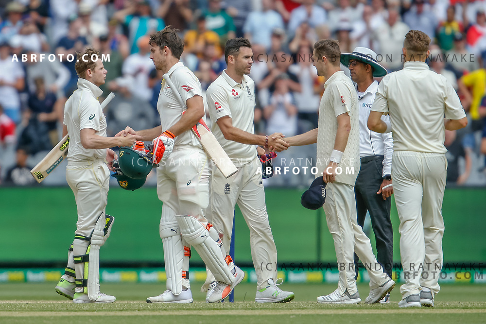 Australian and England players shake hands at the end of play during day 5 of the 2017 boxing day test.