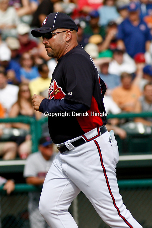 March 5, 2011; Lake Buena Vista, FL, USA; Atlanta Braves manager Fredi Gonzalez (33) during a spring training exhibition game against the New York Mets at Disney Wide World of Sports complex.  Mandatory Credit: Derick E. Hingle