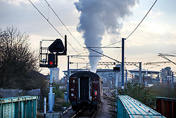 © Licensed to London News Pictures. 24/02/2016. London, UK. The Flying Scotsman passes through Finsbury Park station in north London on Thursday, 24 February 2016. The Scotsman returs to the tracks for after a decade-long, £4.2 million refit which was completed earlier this year for its inaugural passenger service from King's Cross to York. Photo credit: Tolga Akmen/LNP