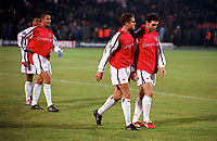 Dejected Arsenal players Martin Keown, matthew Upson, Paolo Vernazza and Ashley Cole leave the field after the defeat by Donetsk . Shakhtar Donetsk 3:0 Arsenal, UEFA Champions League, Group B, Centralny Stadium, Donetsk, Ukraine, 7/11/2000. Credit Colorsport / Stuart MacFarlane.