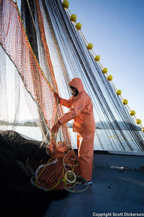 Commercial Fisherman Eric Briese Stacks The Leadline Onboard F V