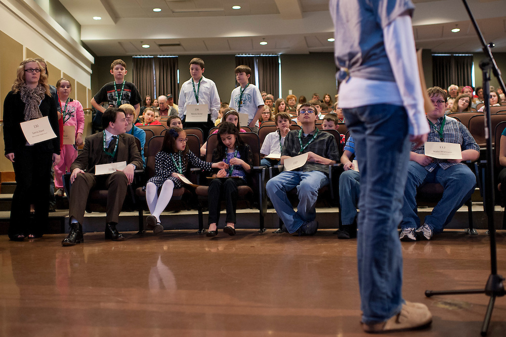 Participants wait for each of the contestants to spell their words before proceeding to the next round of the Southeast Ohio Spelling Bee Regional Saturday, March 16, 2013. The Regional Spelling Bee was sponsored by Ohio University's Scripps College of Communication and held in Margaret M. Walter Hall on OU's main campus.