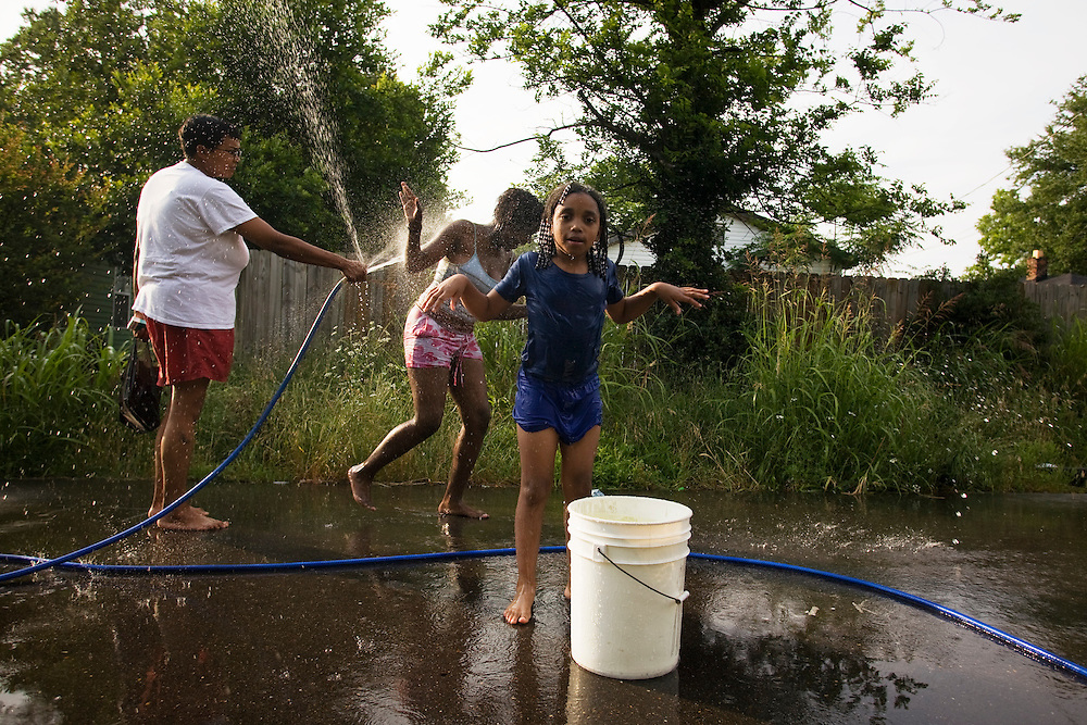 Lacking a public pool in Clarksdale, Miss., a group of children improvise.<br /> Photo by D.L. Anderson