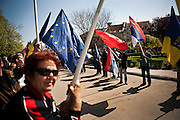 Crowds of supporters wave flags of the EU, Serbia and the Democratic Party on the central square in the Eastern Serbian town of Veliko Gradiste before President Boris Tadic arrived for a campaign event. April 19, 2012...Matt Lutton for The Wall Street Journal..SERBELECT