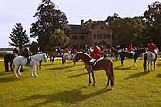 Mounted Fox Hunters wait for the start of the hunt on the greensward of the plantation house at Middleton Place plantation in Charleston, SC.