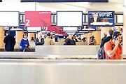 Travelers wait for their luggage at Hartsfield-Jackson Atlanta International Airport in Atlanta, Georgia January 6, 2009.