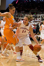 December 19, 2009; Stanford, CA, USA;  Stanford Cardinal forward Kayla Pedersen (14) dribbles past Tennessee Lady Volunteers guard Taber Spani (13) during the first half at Maples Pavilion.  Stanford defeated Tennessee 67-52.