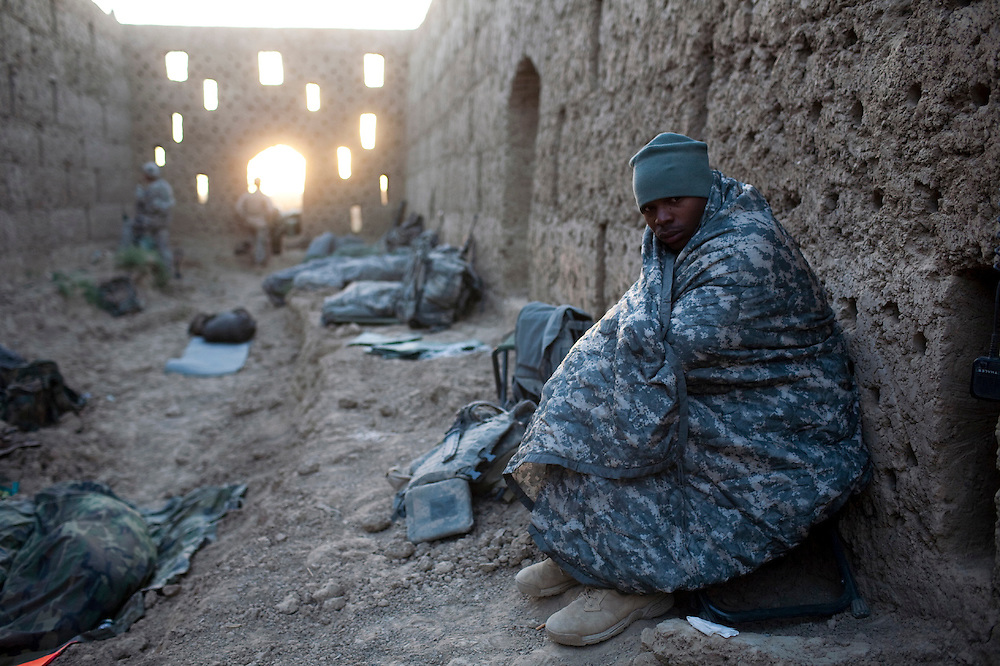 A US Army soldier Jason Mcmillan, from Ventura, California,  from Scout Platoon 2nd Battalion, 502 Infantry Regiment, 101st Airborne Division, wakes up at an outpost in Zhari district, Kandahar province, Saturday, Oct. 9, 2010.  The Scouts' mission was to support roadside bomb clearance efforts in the militant stronghold, the latest days-long phase of Operation Dragon Strike. (AP Photo/Rodrigo Abd)