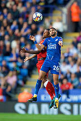 LEICESTER, ENGLAND - Saturday, September 23, 2017: Liverpool's Georginio Wijnaldum and Leicester City's Riyad Mahrez during the FA Premier League match between Leicester City and Liverpool at the King Power Stadium. (Pic by David Rawcliffe/Propaganda)