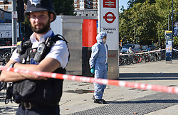 © Licensed to London News Pictures. 13/09/2018. London, UK. A forensic investigator works at the scene of a double stabbing that happened in the early hours of the morning outside Shepherd's Bush tube station. A man in his early thirties was arrested on suspicion of two counts of grievous bodily harm, he remains in police custody. Photo credit: Guilhem Baker/LNP