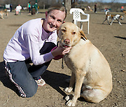 Melinda Stewart and her Labrador Retriever, Winsome, at the White Rock Lake Dog Park on Sunday, February 3, 2013 in Dallas, Texas. (Cooper Neill/The Dallas Morning News)