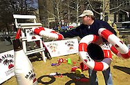 Former Philadelphia Phillies player John Kruk helps participants at the Malibu Flip Flop Camp, Friday, April 5, 2002, in Love Park at JFK Plaza, in Philadelphia, Pa. The event is part of a series of boot camps designed to teach people how to enjoy a more seriously easy-going lifestyle. Winners of the event qualified to compete for an all expense paid trip for two to Barbados, home of Malibu Rum, where one person will have a chance to win a seriously easy-going grand prize, one years salary. (Photo by William Thomas Cain/Getty Images)