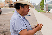 07 AUGUST 2005 - PHOENIX, AZ: YSIDRO, who lives on the streets of Phoenix, AZ, lights a hand rolled cigarette before a church service for street people in downtown Phoenix. The service is performed by ministers from Agape Harvest Church, which holds weekly church services for street people in Phoenix. They also hand out water and food and distribute clothes. They have been involved in the street ministry for about six months. About 50 people usually attend the service and meals.  PHOTO BY JACK KURTZ