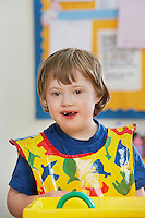 Portrait of boy (5-6) with Down syndrome in kindergarten