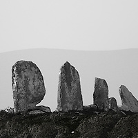 A four-stone alignment, Eightercua consists of four stones, the tallest of which nears 10 feet in height. The alignment extends in an east-west direction for some 25 feet / Located in Waterville, County Kerry, Ireland / wv052