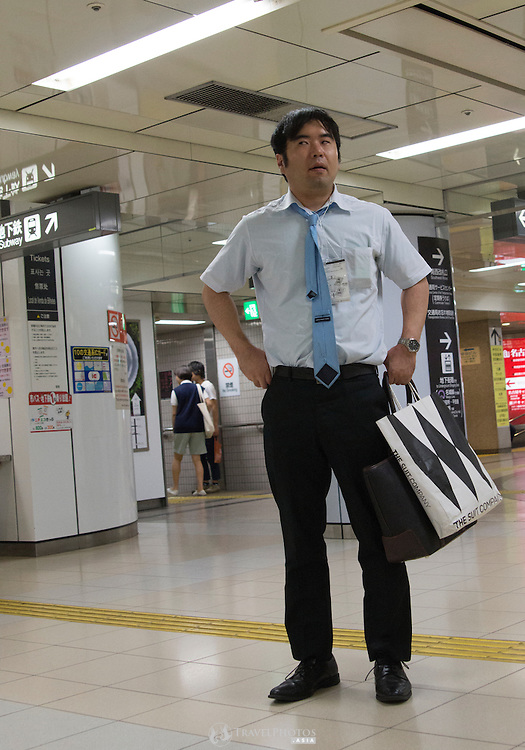 A middle aged man at the Sakae Subway Station on a Sunday evening.