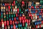 Votive candles in Santa Maria de Montserrat Abbey, Monistrol de Montserrat,  Catalonia, Spain