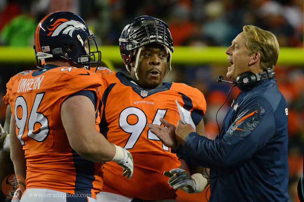 November 17, 2013; Denver, CO, USA; Denver Broncos interim head coach Jack Del Rio (right) instructs defensive tackle Mitch Unrein (96) and defensive tackle Terrance Knighton (94) during the first quarter against the Kansas City Chiefs at Sports Authority Field at Mile High. The Broncos defeated the Chiefs 27-17.